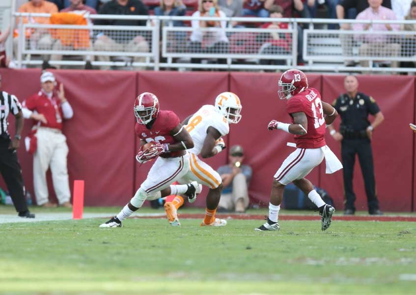 Alabama safety Landon Collins (26) makes an interception against Tennessee. Collins ran the interception back 89 yards for a touchdown and was named the SEC's defensive player of the week. (Source: Alabama Athletics)