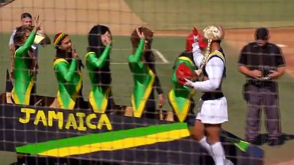 Jamaican bobsled team high fives San Diego Chargers cheerleader after home run. (Source: You Tube)