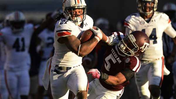 Here is Tre Mason running wild against the horrific Texas A&M defense in the Tigers' big win over the Aggies. (Source: Todd Van Emst/Auburn Media Relations)