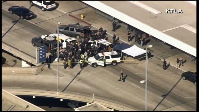 Police and other emergency responders gather outside the LAX terminal Friday after a shooting. (Source: KTLA/CNN)