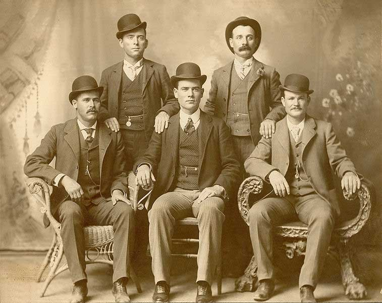 Butch Cassidy, seated far right, and the Sundance Kid, seated far left, are shown here with their gang, The Wild Bunch in 1900. The two were allegedly killed Nov. 7, 1908. (Source: Wikimedia Commons)