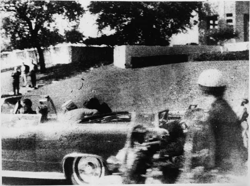 The photograph was taken at the instant of the fatal shot to the head of President John F. Kennedy by Mary Ann Moorman, a bystander in Dallas' Dealey Plaza. It also contains the shadowy figure known as Badge Man. (Source: Wikimedia Commons)