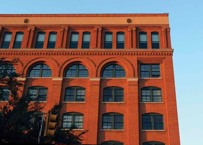 The shot that killed President John F. Kennedy is alleged to have been fired from the sixth floor of the Texas School Book Depository, from the open window in this picture. (Source: The Sixth Floor Museum)