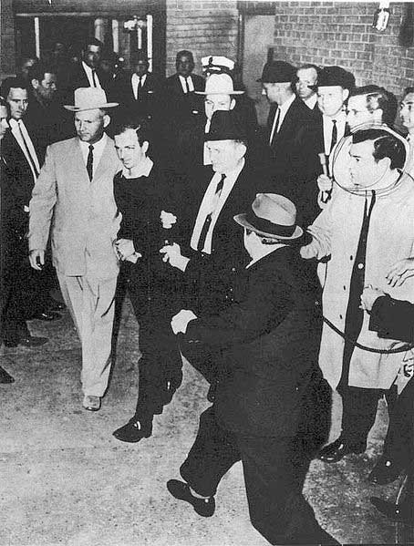 Dallas night club owner Jack Ruby, right, shoots President John F. Kennedy's alleged assassin, Lee Harvey Oswald, at Dallas Police headquarters Nov. 24, 1963. (Source: Wikimedia Commons)
