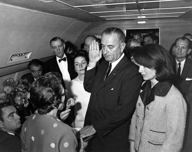 President Lyndon Johnson is sworn in on board Air Force One before returning to Washington, DC, with first lady Jacqueline Kennedy and President John F. Kennedy's body. (Source: Cecil Stoughton/White House Photographs/JFK Presidential Library, Boston)