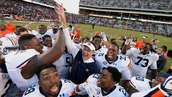 Coach Gus Malzahn and his players celebrate their emotional win over Texas A&M. (Source: Todd Van Emst, Auburn Athletics)