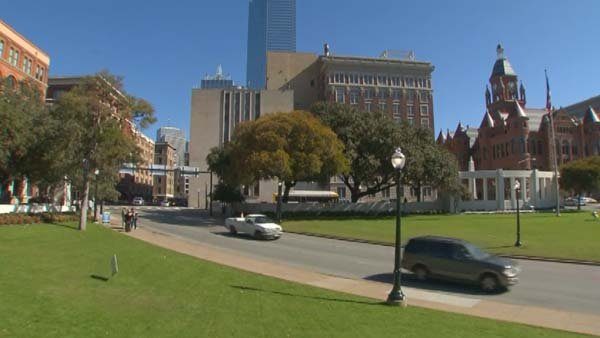 Fifty years after President John F. Kennedy was killed, people still visit Dealey Plaza in Dallas, looking for answers. (Source: CNN)