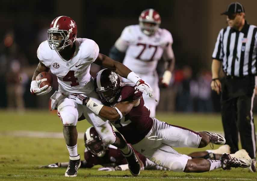Alabama's T.J. Yeldon (4) rushed for a career-high 160 yards in a 20-7 win over Mississippi State. Alabama and Auburn will play each other in two weeks with the winner advancing to the SEC championship game. (Source: Alabama Athletics)