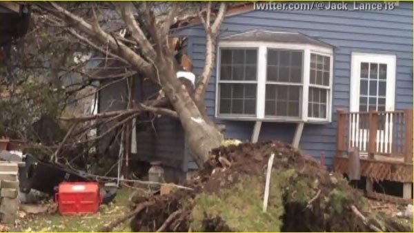 A tornado damaged homes in Pekin, IL. (Source: CNN)