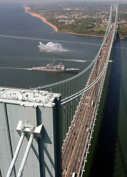 The USS Leyte Gulf sails under the Verrazano-Narrows Bridge during Fleet Week in New York City in 2008. The bridge was the longest suspension bridge in the world when it opened Nov. 21, 1964. (Source: U.S. Navy/Wikimedia Commons)
