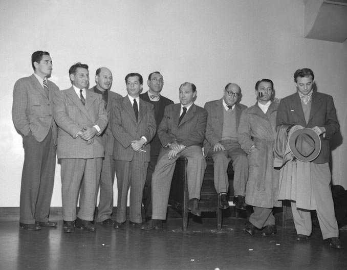 Nine members of the blacklisted Hollywood Ten. (Source: Wikimedia Commons)
