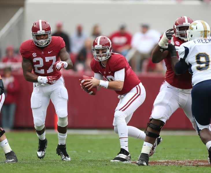 Alabama quarterback AJ McCarron leads him team into the Iron Bowl looking for a third straight national championship. McCarron is also chasing a long shot bid at the Heisman Trophy. (Source: Alabama Athletics)