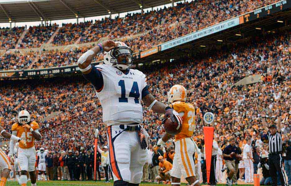 Auburn quarterback Nick Marshall will try to lead the resurgent Tigers and their No. 2 rushing offense against Alabama's top-ranked scoring defense. (Source: Todd van Emst/Auburn Univers