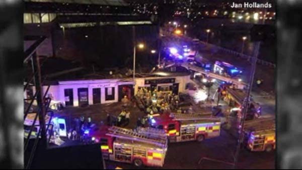 A helicopter crashed into the roof of a pub in Scotland Friday. (Source: Jan Hollandsl/CNN)