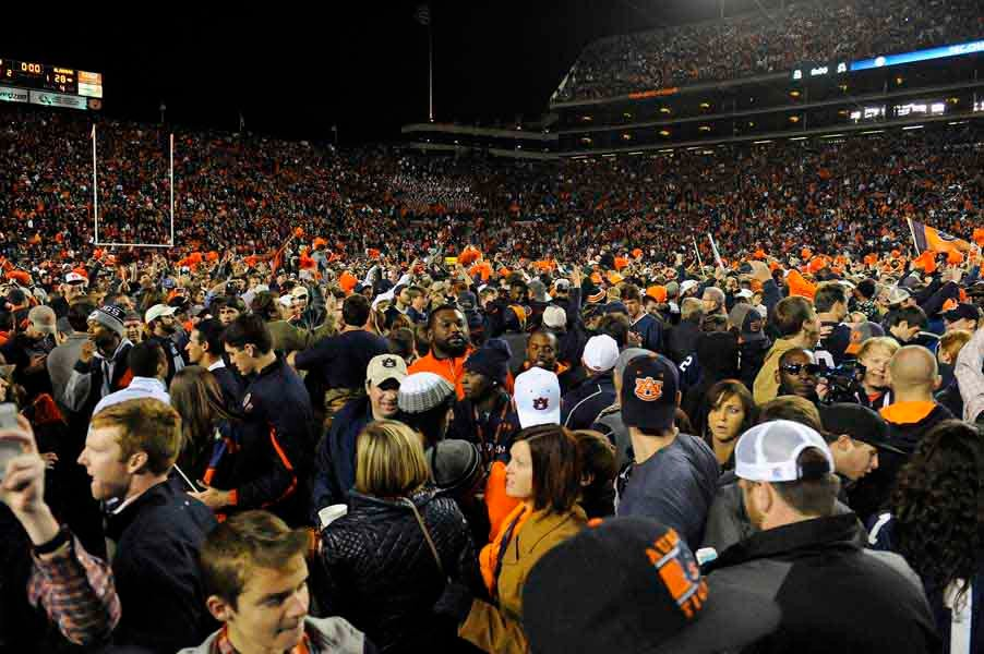Most of the fans at Jordan-Hare Stadium turned the field into a sea of orange and blue humanity following Auburn's win in the Iron Bowl. (Source: Todd van Emst/Auburn University)