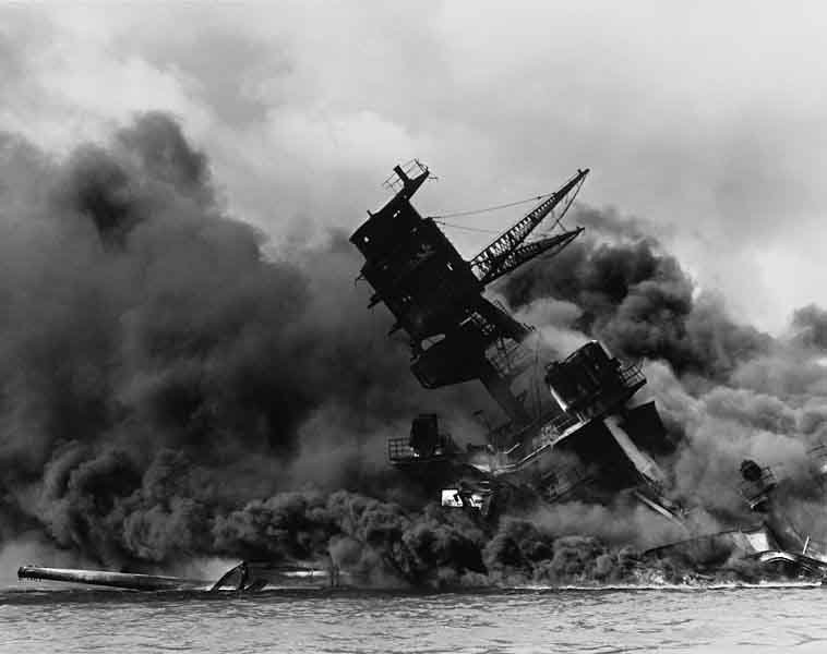 The USS Arizona in flames after it was destroyed in the attack on Pearl Harbor. (Source: U.S. Navy/Wikimedia Commons)