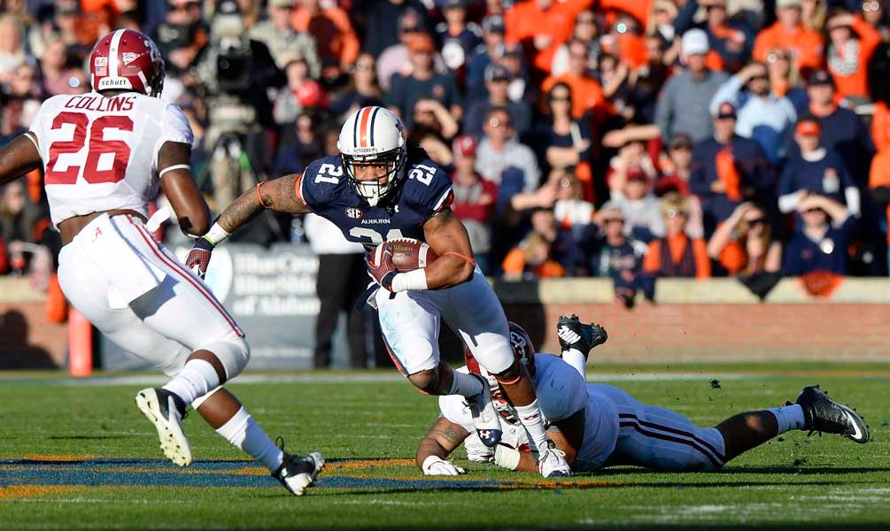 Auburn running back Tre Mason (21) leads the Southeastern Conference in rushing and will help Auburn try to capture the SEC championship Saturday. (Source: Todd van Emst/Auburn University)