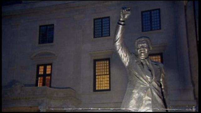 A statue of Nelson Mandela stands outside the South African embassy in Washington, DC. (Source: CNN)