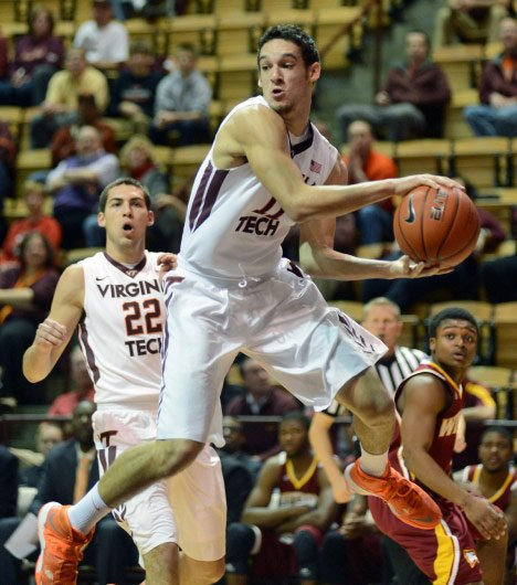 Virginia Tech freshman Devin Wilson (11) makes a leaping play against Winthrop on Tuesday. He and the Hokies take on Miami in the ACC season opener. (Source: Hokiesports.com)