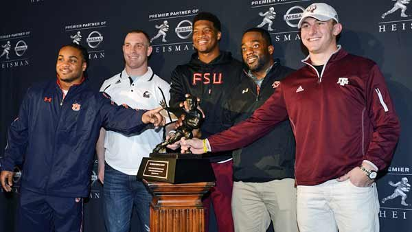 Heisman finalists, from left, Tre Mason, Jordan Lynch, Jameis Winston, Andre Williams and Johnny Manziel pose with the trophy. AJ McCarron was in Baltimore to accept the Johnny Unitas Golden Arm Award. (Source: Todd Van Emst/Auburn University)