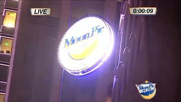 The giant, lighted MoonPie descended to mark the last minute of 2013. (Source: WLOX)