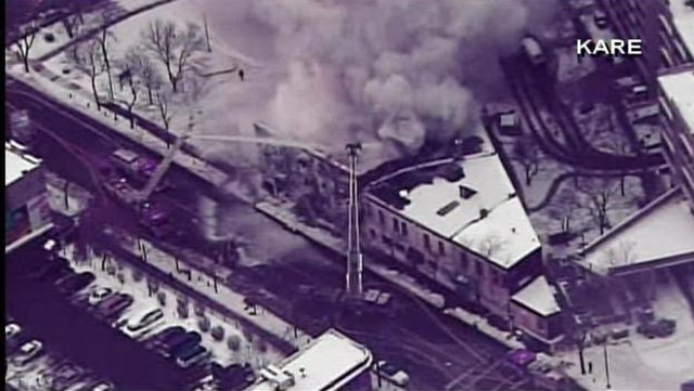 Firefighters work to get an apartment building fire under control in Minneapolis, MN. (Source: KARE/CNN)