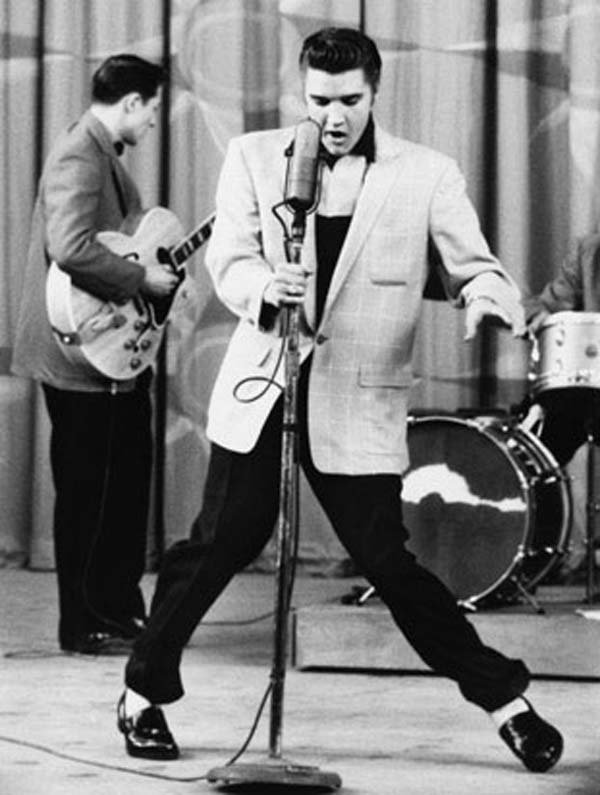 Elvis Presley performing on The Milton Berle Show. (Source: Wikimedia Commons)