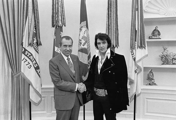 Elvis Presley meets President Richard Nixon in the White House. Presley was born Jan. 8, 1935, and Nixon was born Jan. 9, 1913. (Source: White House/Wikimedia Commons)