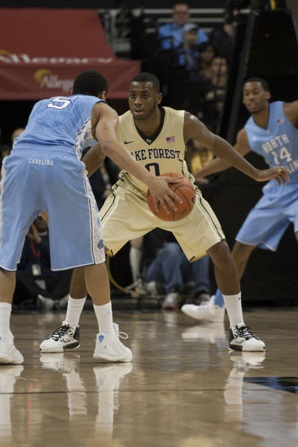 Wake Forest's Codi Miller-McIntyre (0) guards North Carolina's Marcus Paige on Saturday. Wake won 73-67. (Source: WakeForestSports.com)