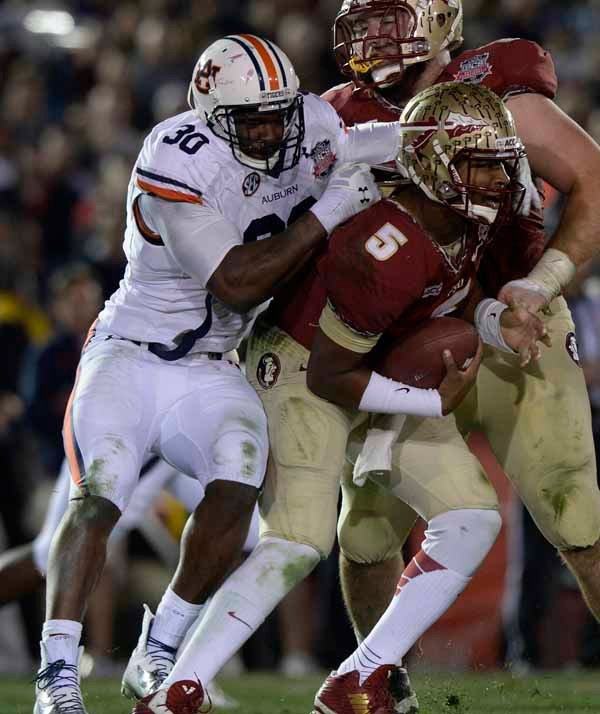 Auburn's Dee Ford (30) tackles Florida State quarterback Jameis Winston (5). (Source: Todd van Emst/Auburn University)