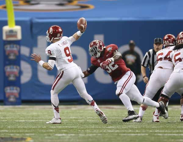 Oklahoma quarterback Trevor Knight (9) passes against Alabama prior to being hit by linebacker C.J. Mosely (3