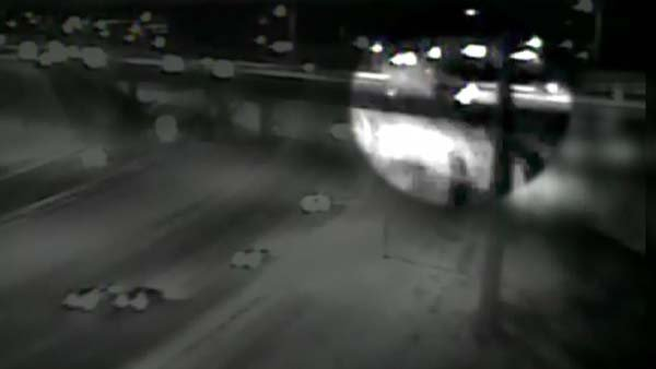Minnesota Department of Transpiration video caught a truck driving off an overpass in icy conditions. (Source: MN Dept. of Transportation/CNN)