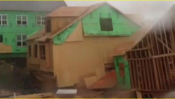 Strong winds knock over condominium under construction. (Source: ED BRAZ/CNN)