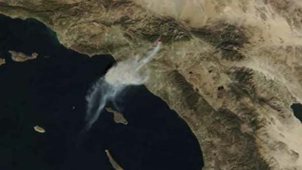 This satellite photo from NASA shows the wildfire from space. (Source: NASA/CNN)
