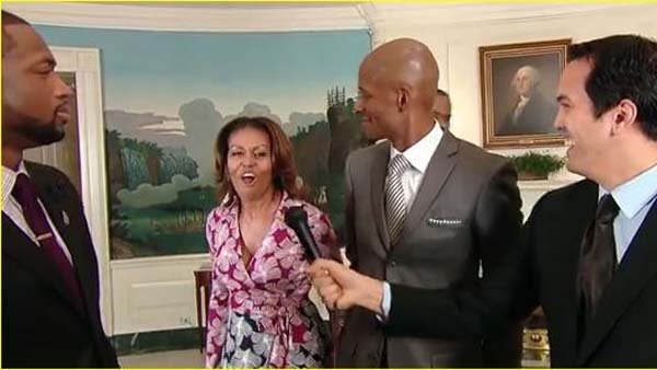 First Lady Michelle Obama video bombed members of the Miami Heat during their visit to the White House while taping a PSA. (Source: YouTube)
