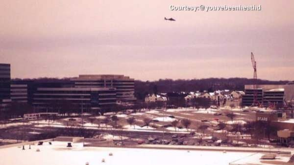 A police helicopter flies over the scene at the Mall in Columbia. (Source: @youvebeenhealthd/CNN)