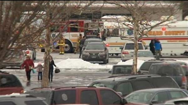People leave the mall as police check out the scene. (Source: CNN)