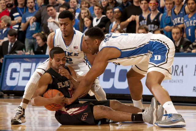 The Duke Blue Devils have cranked up the intensity on the defensive end. Pictured are Quinn Cook (left) and Jabari Parker (right) trying to take the ball from a Florida State player. (Source: Duke Photography/GoDuke.com)