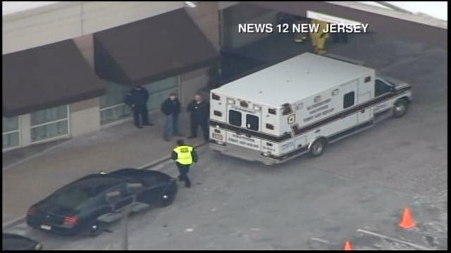 Emergency crews park outside a New Jersey hotel. (Source: News 12 NJ/CNN)