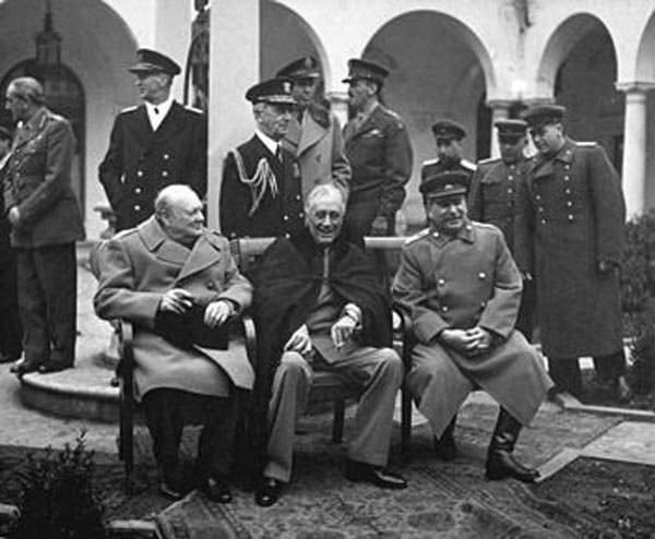 President Franklin Roosevelt, middle, meets with Winston Churchill, left, and Josef Stalin, right, during the Yalta Conference. (Source: Wikimedia Commons)