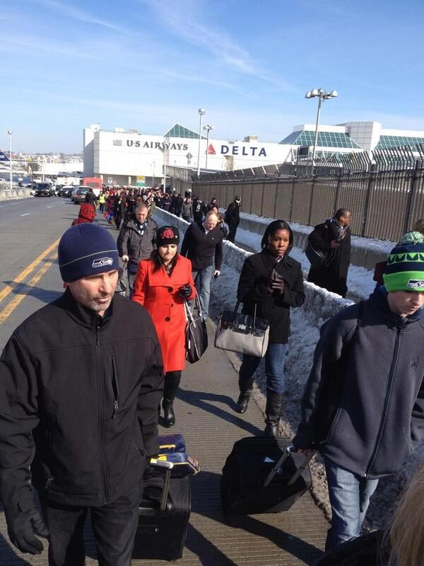 People who were waiting on flights walk away from Terminal C at LaGuardia Airport after the report of a suspicious bag. (Source: Dionna Widder/@DW_LeagueRep)