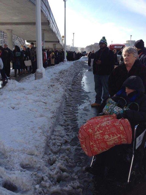 People wait outside LaGuardia Airport while authorities investigate a suspicious bag. (Source: Phillip Capper / Flickr)
