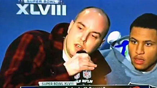 Matthew Mills, left, crashed the Super Bowl postgame press conference and needed only a few seconds to deliver his message. (Source: The Regner Brothers/Vine)