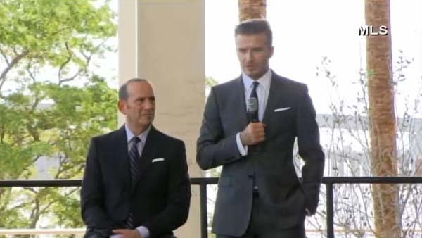 Soccer star David Beckham, right, and Major League Soccer Commissioner Don Garber, announces plans to bring a professional team back to Miami. (Source: MLS/CNN)