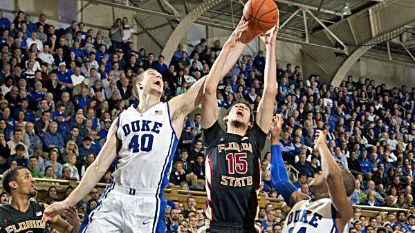 The development of FSU center Boris Bojanovsky (15), shown fighting Duke center Marshall Plumlee (40) for a rebound, is key for the success of the Seminoles. (Source: Duke Photography)