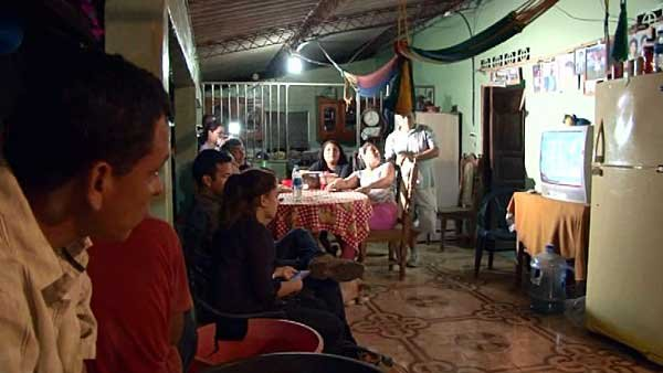 Alvarenga's family and friends gather at his parents home in Garita Palmera, El Salvador to watch his return on television. (Source: CNN)