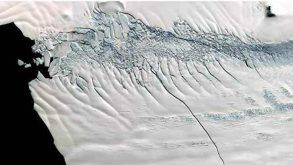 "This 19-mile crack appeared in the massive Pine Island Glacier in October 2011and led to the ""calving"" of an iceberg the size of Chicago. (Source: NASA/GSFC/METI/ERSDAC/JAROS, and U.S. Ja"