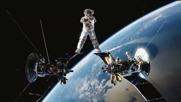 Jean Claude Van Damme's epic split from the Volvo ad takes on zero-gravity. (Source: Linh Mai/YouTube)