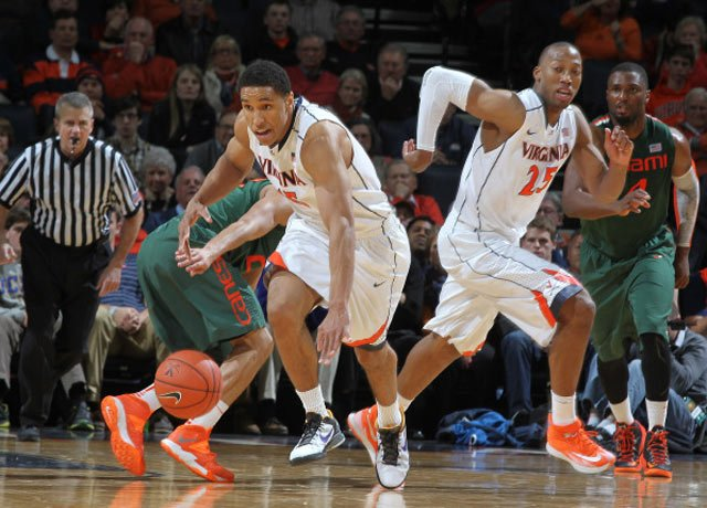 Malcolm Brogdon (15), Akil Mitchell (25) and the Virginia Cavaliers could clinch a share the ACC regular season title Saturday with a win over Syracuse. (Source: Matt Riley/VirginiaSports.com)