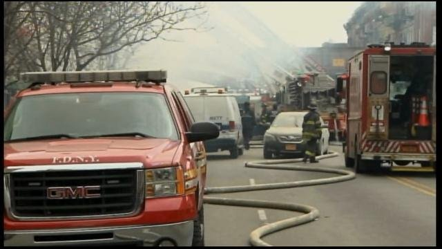 Fire crews and first responders canvass the scene of the explosion in Manhattan. (Source: News 12 Long Island/CNN)